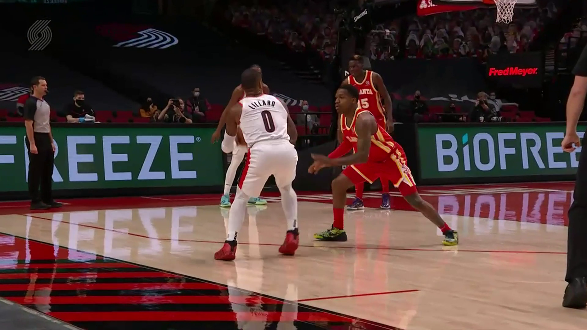 Damian Lillard buries a three directly in the defender's face