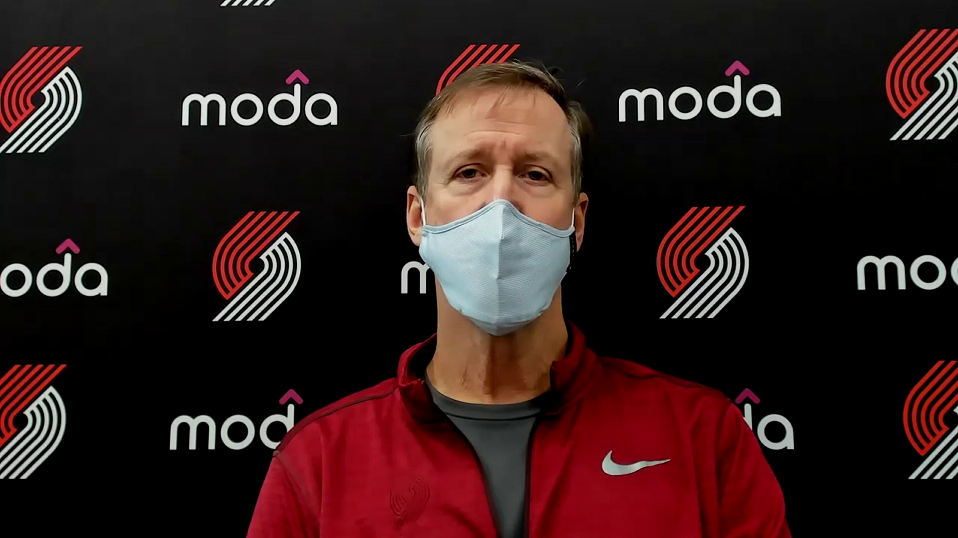 Coach Stotts talks to media at practice on Wednesday