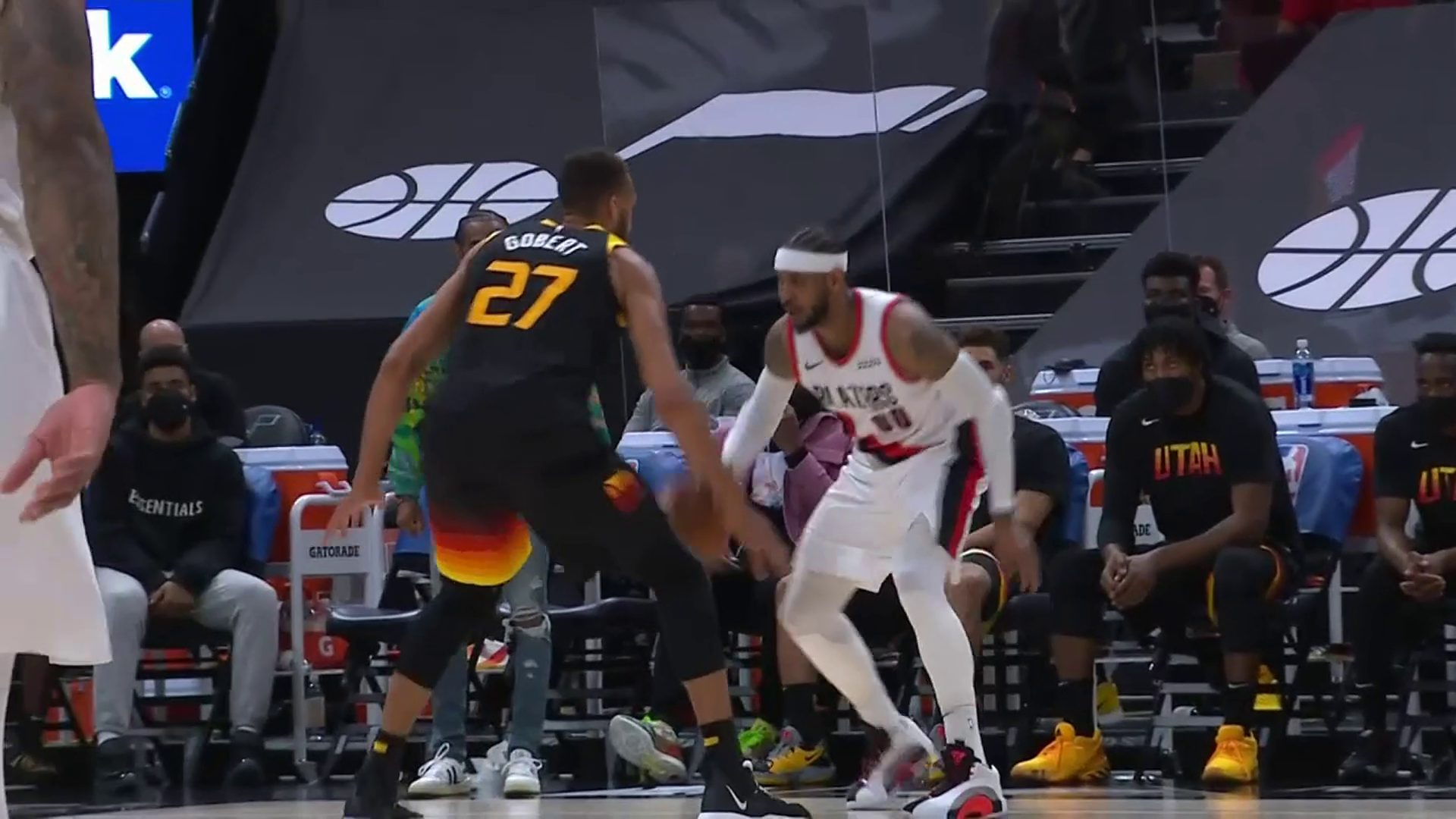 Carmelo Anthony with the ice cold bucket over Gobert