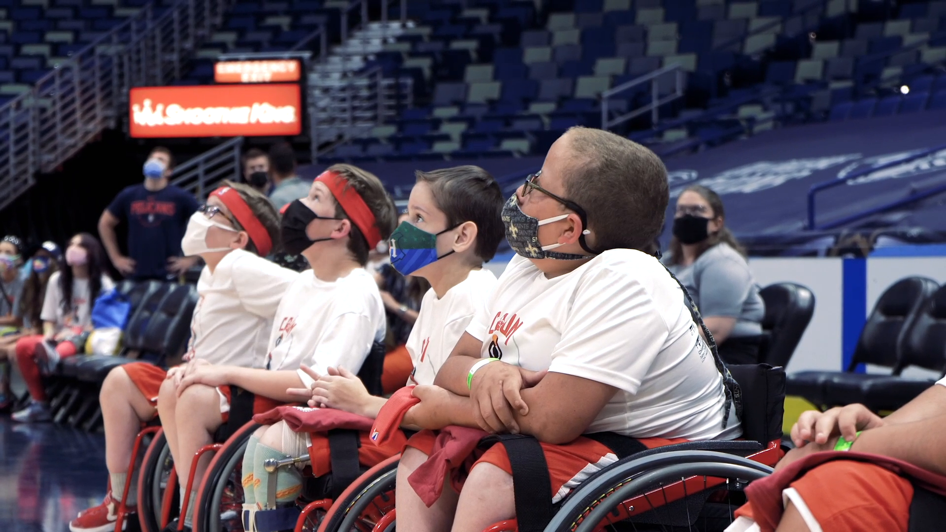 Pelicans celebrate Cajun Wheelers youth basketball team with a special gift